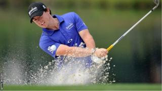 McIlroy plays a bunker shot during the second round