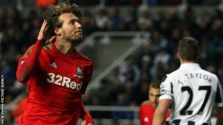 Michu celebrates after scoring Swansea's opening goal