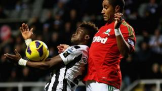 Ashley Williams battles for the ball with Newcastle's Cheick Tiote