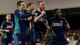 Sunderland players celebrate their third goal