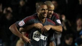 Bolton celebrate David Ngog's last gasp equaliser
