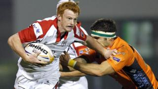 Ulster try-scorer Peter Nelson tries to brush past Marco Fipippucci in the Pro12 clash