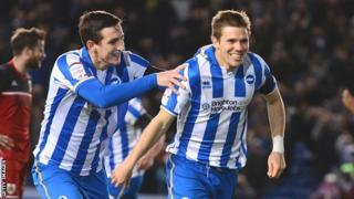 Dean Hammond of Brighton (right) celebrates with team mate Lewis Dunk after opening the scoring