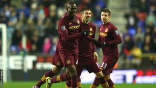 Mario Balotelli celebrates giving Manchester City the lead.