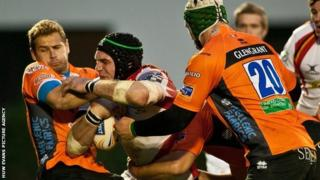 Newport Gwent Dragons' lock Robert Sidoli runs into heavy traffic as his side are beaten 32-13 by Treviso in the Rabo Direct Pro 12 league match on Saturday.