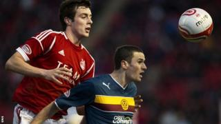 Shaughnessy (left) in action against Motherwell