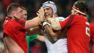 Munster forwards Mike Sherry and David Kilcoyne clash with Will Fraser at Thomond Park
