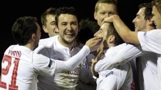 Linfield players celebrate Michael Carvill's goal against Ballinamallard United