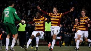 Bradford City players celebrate victory over Arsenal