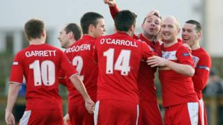 Cliftonville players celebrate Marc Smyth's second goal against Ballinamallard
