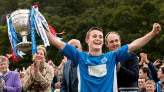 Kyles Athletic captain Andrew King lifts the Camanachd Cup after helping the Tighnabruaich team beat Inveraray in the final at Mossfield Park, Oban