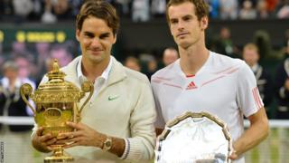 Wimbledon men's singles winner Roger Federer and runner-up Andy Murray pose with their trophies