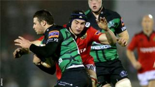 Munster's Tommy O'Donnell tackles Connacht's Robbie Henshaw