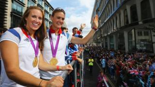 Rowers Helen Glover (left )and Heather Stanning take part in the London 2012 Victory Parade for Team GB and Paralympics GB athletes