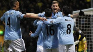 Manchester City celebrate Edin Dzeko (second right) scoring at Norwich