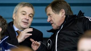 Uefa general secretary David Taylor (left) chats with Livingston chairman Gordon McDougall
