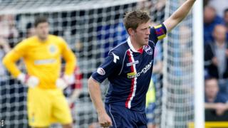 Richard Brittain celebrates scoring against Celtic from a free-kick