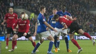 As the snow falls in the Welsh capital, Cardiff City captain heads wide as the Championship leaders are held to a goalless draw by Ipswich