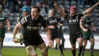 Ospreys celebrate as number eight Joe Bearman scores a try against Leicester to give them an early advantage in their Heineken Cup tie at Liberty Stadium