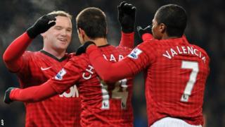 Manchester United's English striker Wayne Rooney celebrates scoring the only goal