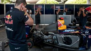 Red Bull engineers work on their car
