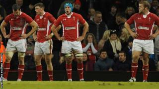 Wales players are dejected after defeat to Australia