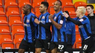 Jason Scotland (left) celebrates scoring for Blackpool