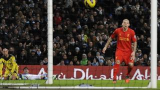 Manchester City striker Sergio Aguero (centre) looks on as he scores his side's equaliser against Liverpool