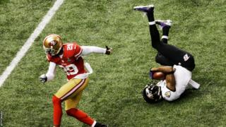 Jacoby Jones (right) scores his first touchdown during Super Bowl XLVII