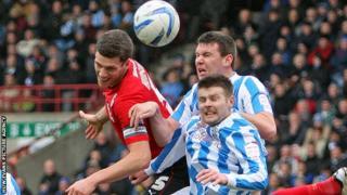 Cardiff captain Mark Hudson in action against Huddersfield
