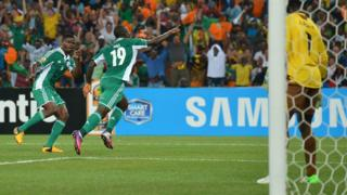 Sunday Mba (centre) wheels away in delights after scoring a brilliant goal to put Nigeria 1-0 up against Burkina Faso in the Africa Cup of Nations final