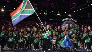 Oscar Pistorius carrying the South African flag at 2012 Paralympics in London.