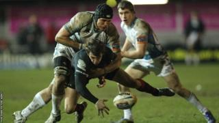 Newport Gwent Dragons' Steffan Jones is tackled by Glasgow's Tim Swinson as the Welsh region are hammered 60-3 at home