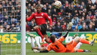 Fraizer Campbell clips the ball past Bristol City goalkeeper Tom Heaton to give Cardiff City the lead in their home Championship encounter