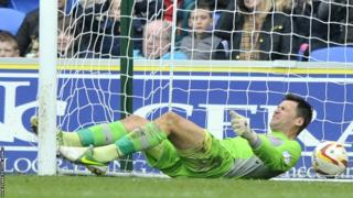 Cardiff City goalkeeper David Marshall is beaten by a back-header from team-mate Ben Nugent but Cardiff hold on to beat Bristol City 2-1