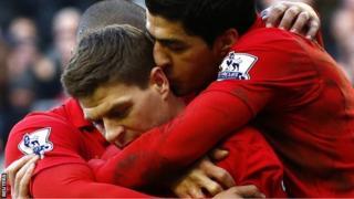 Steven Gerrard is congratulated by Liverpool team-mates