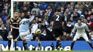 Carlos Tevez fires City's second goal