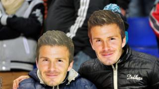 Two Paris St-Germain FC fans wear David Beckham masks during the Ligue 1 match between Sochaux and Paris Saint-Germain
