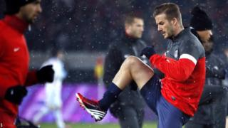 David Beckham stretched and strained as he warmed up to face Marseille
