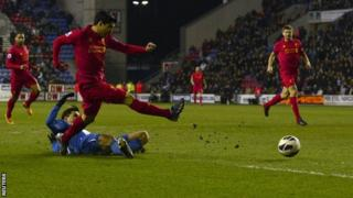 Luis Suarez scores his third for Liverpool