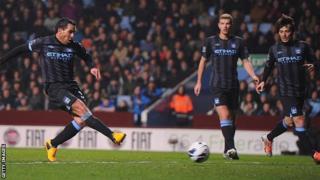 Carlos Tevez scores for Manchester City