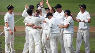 New Zealand players celebrate the wicket of Matt Prior, Bruce Martin's first in Test cricket