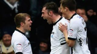Richard Keogh [centre] is congratulated after his first-half goal