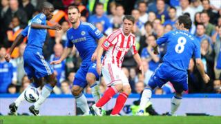 Michael Owen playing against Chelsea earlier this season