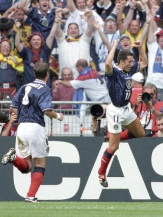 Scotland midfielder John Collins (right) celebrates in front of the Tartan Army