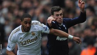 Swansea's Ashley Williams in Premier League action against Tottenham's Gareth Bale