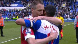 QPR's Clint Hill and Reading's Jobi McAnuff embrace at the final whistle