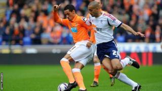 Blackpool's Tom Ince battles for possession