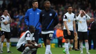 Peterborough's players look dejected after their relegation is confirmed