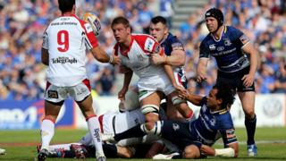 Chris Henry passes the ball to Ruan Pienaar after turning the ball over for Ulster